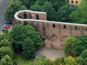 An aerial view of the Berlin church where a beaten body bearing an Israeli passport was found.