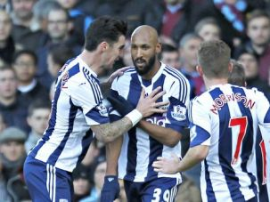 Controversial Salute: Nicolas Anelka, center, celebrates his goal in a game Saturday. He later flashed the ?quenelle,? a gesture reminiscent of the Nazi salute.