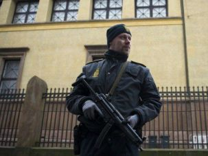 A police officer stands guard outside the Krystalgade synagogue in Copenhagen.