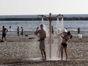 Sun and War: Even with rockets fired from Gaza peppering Israel, some flocked to the beach in Tel Aviv.