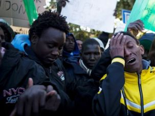 Crying Shame: An African migrants cries as Israeli police and immigration officers prepare to arrest them during a demonstration outside the Israeli Parliament.