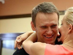 Moscow Mayoral: Candidate Alexei Navalny, shown hugging his wife, is denying making anti-Semitic comments.