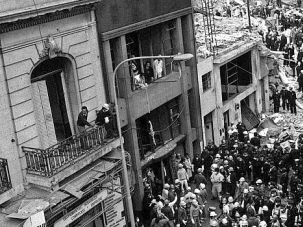 Death Trap: Authorities gather outside Buenos Aires Jewish center where car bomb killed 29 people in 1994.