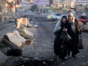Trickle of Worshippers: Palestinian women head to Jerusalem from the occupied West Bank for Friday prayers. The usual flood of worshippers was cut to a trickle by tight Israeli restrictions.