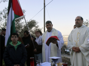 One People: Christian Palestinians protest a portion of the Israeli security wall in the occupied West Bank. A new Israeli law seeks to enhance the status of Christians, with the goal of dividing them from Muslims.