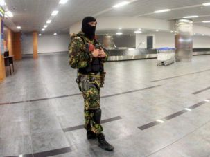 Chaos Reigns: Pro-Russia militant roams terminal in Donetsk Airport, where the Jewish Agency mounted a rescue operation last summer to get two families awaiting aliyah to another city.
