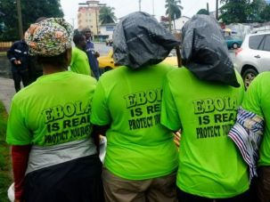 Help Needed: African health workers raise awareness about the danger of the deadly Ebola virus.