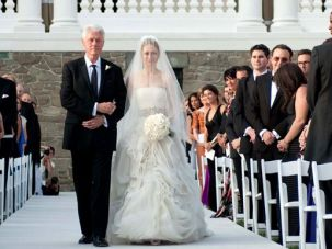 Interfaith Ceremony: Chelsea Clinton and former President Bill Clinton walk down the aisle during her Sabbath day wedding. Among the guests was a man (on right, back to camera) who wore a yarmulke.