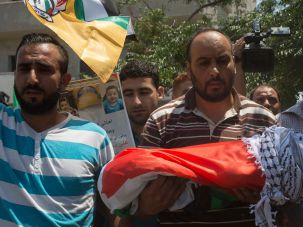 Child killed in West Bank arson in July is buried.