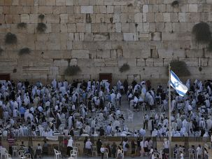 Worshippers pray at the Western Wall in the Old City of Jerusalem during the holiday of Sukkot.