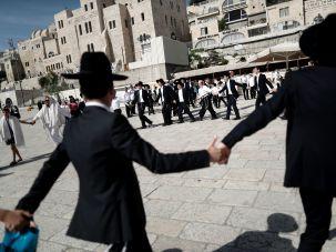 Orthodox Jews dance at Western Wall.
