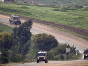 Tension: Israeli military vehicles patrol border with Gaza after another barrage of rockets hit southern Israel.