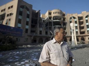 College of Ruins: Kamaleen Shaath, the director of the Islamic University of Gaza inspects the damage at institution in Gaza City after Israeli attack.