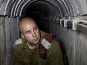 Israeli soldier inspects network of tunnels beneath Gaza border.
