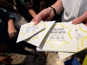 What About Us: Volunteer hands out programs at a Holocaust remembrance event. Young Jews say their groups should get a piece of funding alongside activities of the main umbrella group.