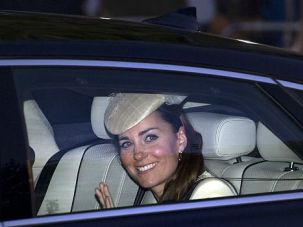 Holy Land Water: Kate Middleton, the mother of Prince George, arrives at his christening in London.