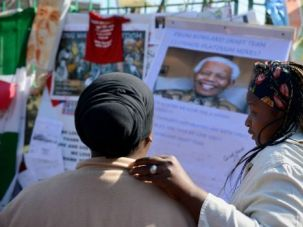 Mandela?s Moment: South Africans gather outside a hospital where ailing iconic leader Nelson Mandela is being treated.