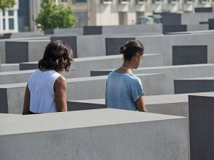 Somber Visit: Michelle Obama and first daughters Sasha and Malia visit the Holocaust memorial in Berlin.