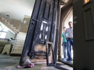 Hate Crime: Congregants inspect damage from arson attack on a mosque in northern Israel.