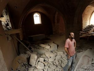 Reduced to Rubble: Palestinians inspect damage at a historic mosque destroyed in an Israeli attack.