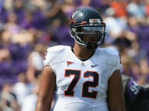 Backing: N.Y. Jets rookie lineman Oday Aboushi, shown here playing for the University of Virginia, insists he is pro-Palestinian, not anti-Israel.