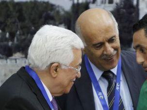Post-Match Ashraf Nu'man (right) talks to Jibril Rajoub (center) and Mahmoud Abbas.