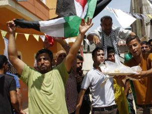 1 People: Palestinians celebrate unity government in Gaza.