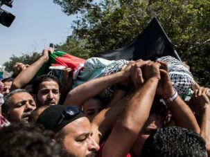 Grief and Anger: Mourners carry body of 16-year-old Mohammed Abu Khudair at his funeral in Jerusalem.