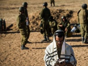 Pray for Peace: Israeli soldier prays as brief truce goes into effect in Gaza. Talks have reached agreement on a permanent ceasefire deal, but both Hamas and Israel must formally approve it.