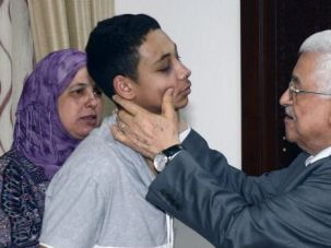 Unbowed: Tariq Khdeir, the American boy beaten by Israeli troops, meets Palestinian President Mahmoud Abbas in Ramallah.