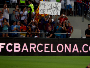 No Soccer for You: Israeli fans hold up sign as Barcelona star Lionel Messi plays in friendly match in Tel Aviv last year.