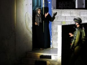 Where Are They? Israeli soldiers interrogate a Palestinian woman as they search for three kidnapped yeshiva students.