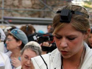 Prayerful Protest: A member of Women of the Wall prays at the Kotel.