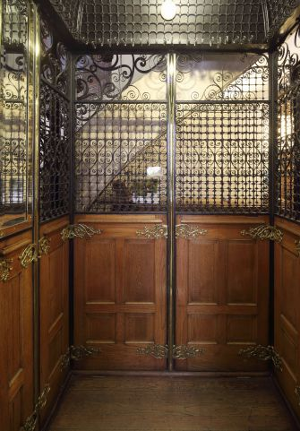 The interior of an original Art Nouveau style elevator, designed by Dubois and Pater, with all the fixtures intact.