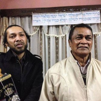 Malagasy Diaspora: Touv'yah, left with Torah, and an unidentified community member.