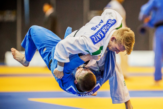 Judo Jew: Nathan Katz, in white, throws an opponent in a judo match.