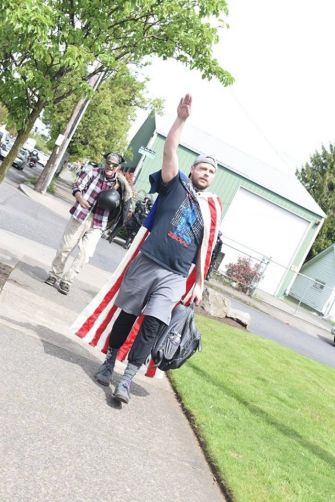 Jeremy Christian giving a Nazi salute earlier this spring.