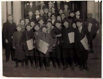 Hot Off the Press: Newspaper boys line up outside the Forward Building in the early hours of the morning to pick up new issues.