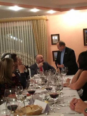 Shabbat Shalom: Daniels chats with Father Tadeusz Rydzyk at a Sabbath dinner Daniels hosted last November.
