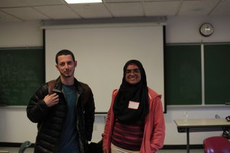 Queens College classmates Jeremy Pitts and Amer Ashraf act out Palestinian and Israeli diplomats in a semester-long role playing course.