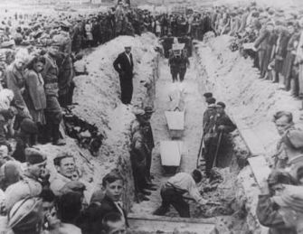 Mourners crowd around a narrow trench as coffins of pogrom victims from the Kielce massacre in July 1946 are placed in a common grave.