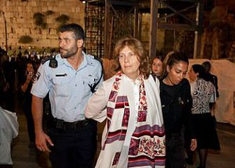 Anat Hoffman is led away by police after women?s prayer protest at the Western Wall.