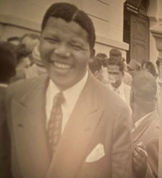 Mandela leaving the Old Synagogue, Pretoria, used as a courtroom during his 1958 treason trial.