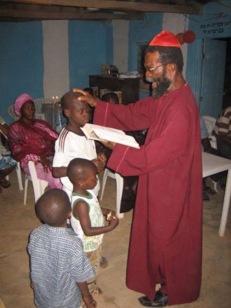 An Igbo elder blesses the children.