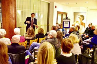 Seeking Solace at the Mall: Rabbi Joshua Caruso holds a meeting January 11 for congregants at La Place Center, a suburban Cleveland shopping mall, for attendees to voice their feelings after the election of Donald Trump as president.
