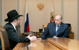Russian leader Vladimir Putin (right) meets with Chabad's Russian chief rabbi, Berl Lazar, in June 2007.