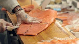 Handle With Care: Len Berk slices through a side of Nova at Zabar's delicatessan in Manhattan.