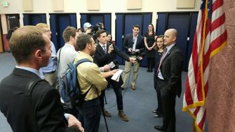 McMullin and Finn talk to the media at the American Preparatory Academy in Draper, Utah.