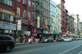 New Look: Chinese businesses line the street of East Broadway in Manhattan, near the Forward Building.