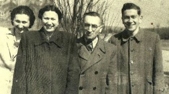 After the War: Edmund Mayer (far right) is seen here at the age of 17 with his family in 1945 in a displaced persons camp near Munich.